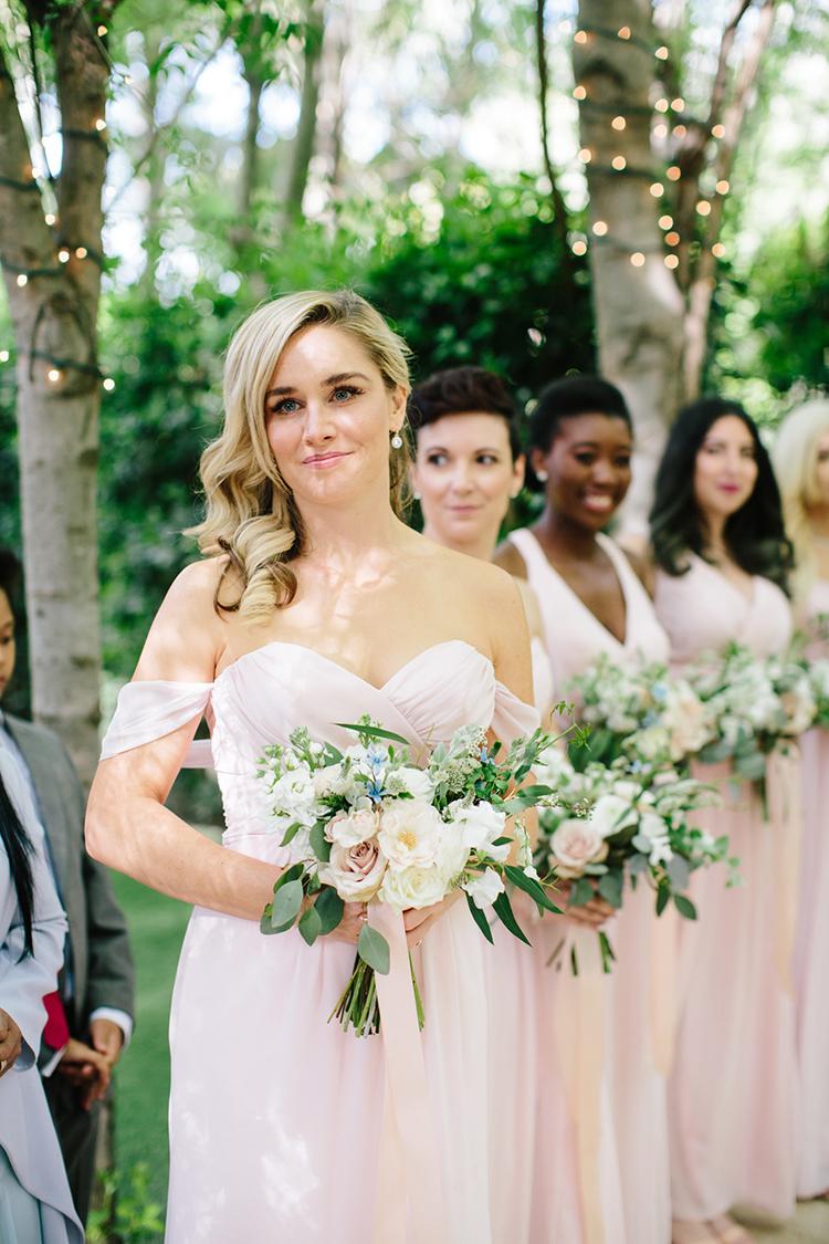 pink bridesmaid dresses - photo by Mirelle Carmichael https://ruffledblog.com/magical-midsummer-nights-dream-wedding