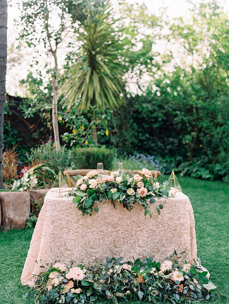 romantic sweetheart table ideas - photo by Mirelle Carmichael https://ruffledblog.com/magical-midsummer-nights-dream-wedding