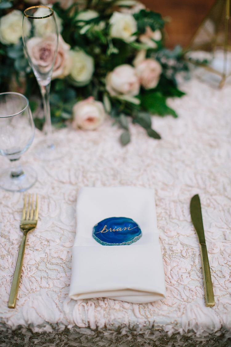 place settings with agate slices - photo by Mirelle Carmichael https://ruffledblog.com/magical-midsummer-nights-dream-wedding