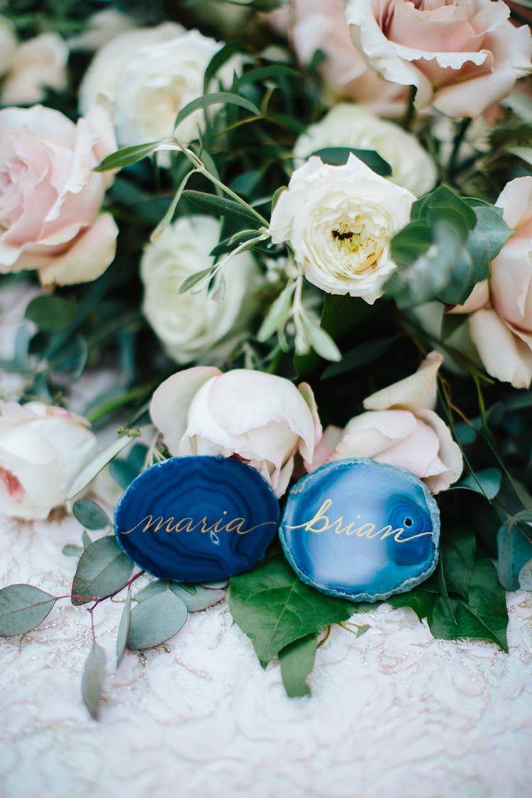 agate slice place cards - photo by Mirelle Carmichael https://ruffledblog.com/magical-midsummer-nights-dream-wedding