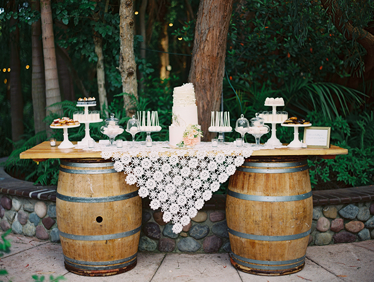 wedding cake tables - photo by Mirelle Carmichael https://ruffledblog.com/magical-midsummer-nights-dream-wedding