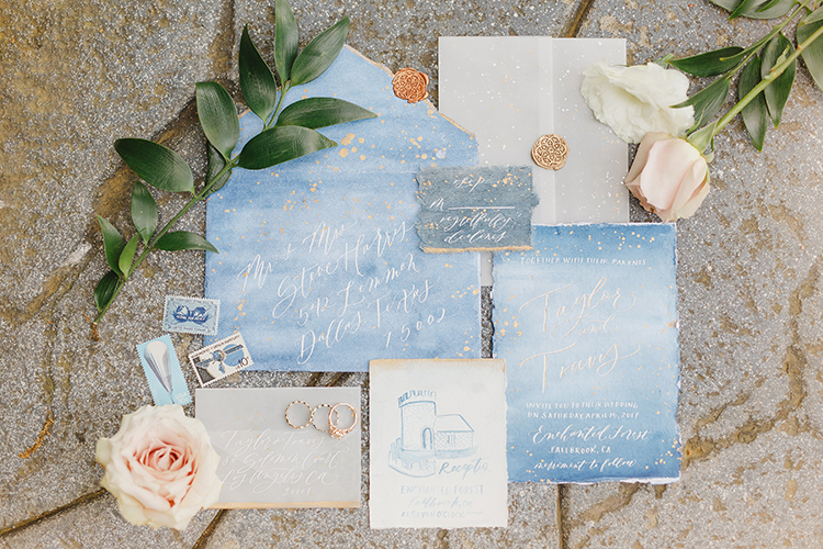blue watercolor wedding invitations - photo by Kristen Booth Photographer http://ruffledblog.com/majestic-castle-wedding-inspiration-with-celestial-accents