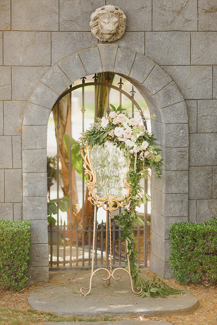 mirrored wedding signage - photo by Kristen Booth Photographer https://ruffledblog.com/majestic-castle-wedding-inspiration-with-celestial-accents