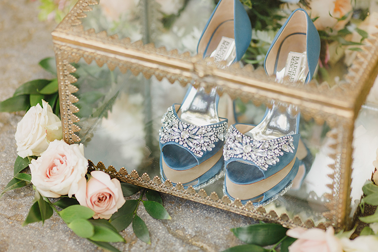 blue wedding shoes - photo by Kristen Booth Photographer https://ruffledblog.com/majestic-castle-wedding-inspiration-with-celestial-accents