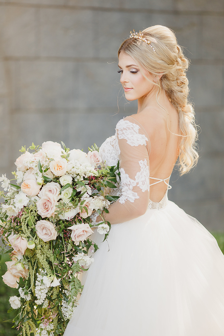 lace sleeve wedding dresses - photo by Kristen Booth Photographer https://ruffledblog.com/majestic-castle-wedding-inspiration-with-celestial-accents