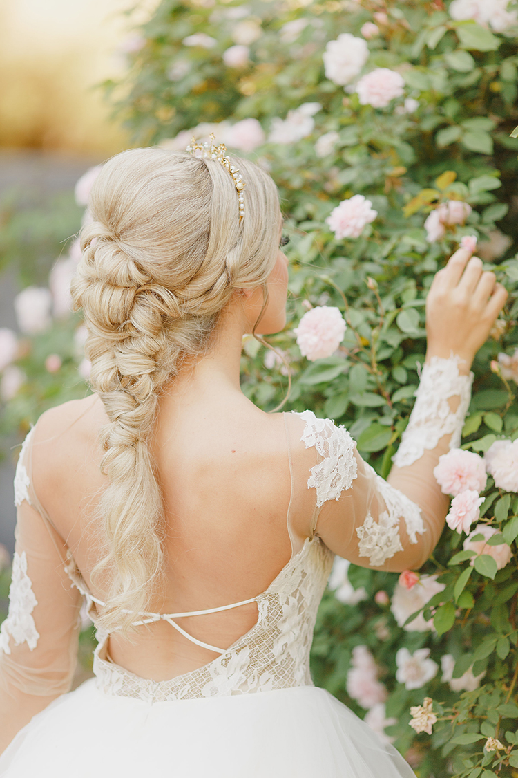 braided bridal hair - photo by Kristen Booth Photographer http://ruffledblog.com/majestic-castle-wedding-inspiration-with-celestial-accents