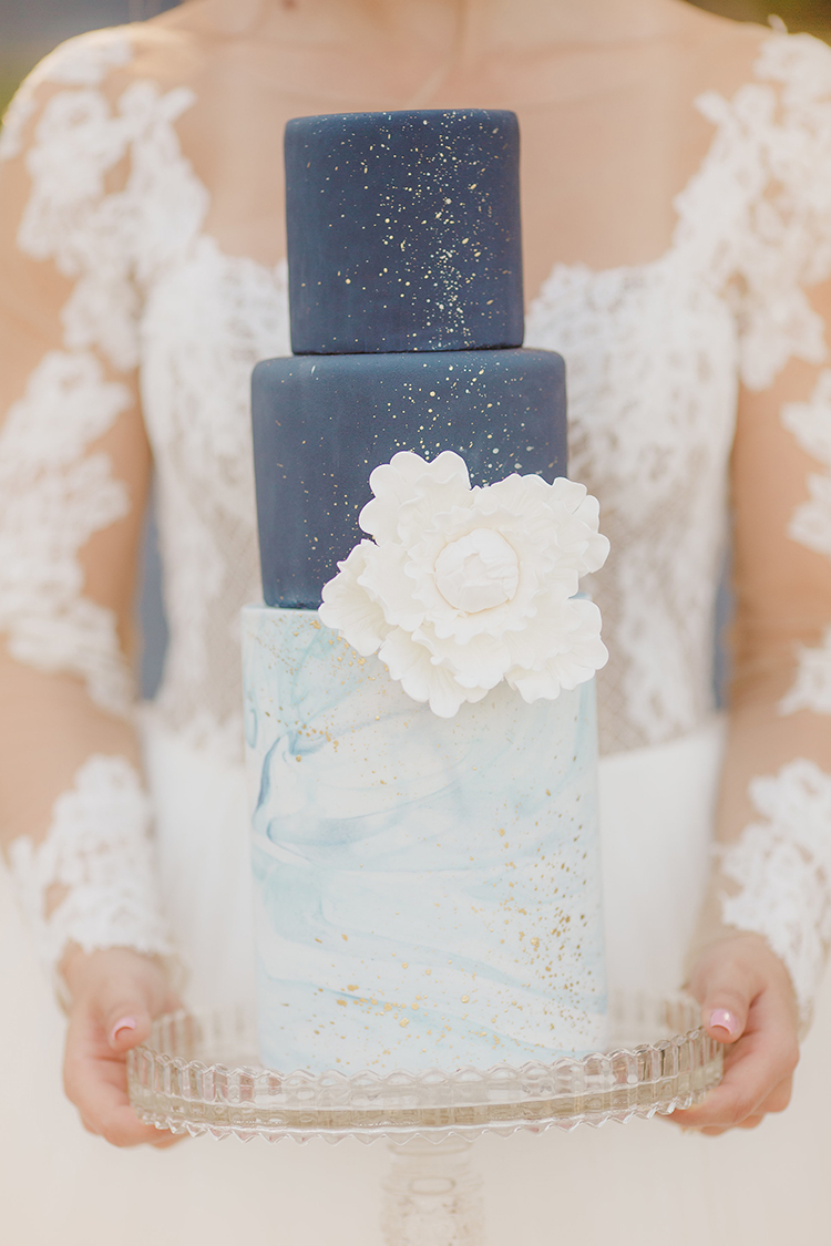 blue wedding cakes - photo by Kristen Booth Photographer https://ruffledblog.com/majestic-castle-wedding-inspiration-with-celestial-accents
