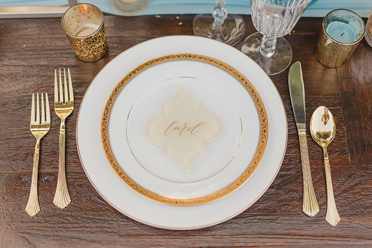 classic place settings - photo by Kristen Booth Photographer https://ruffledblog.com/majestic-castle-wedding-inspiration-with-celestial-accents