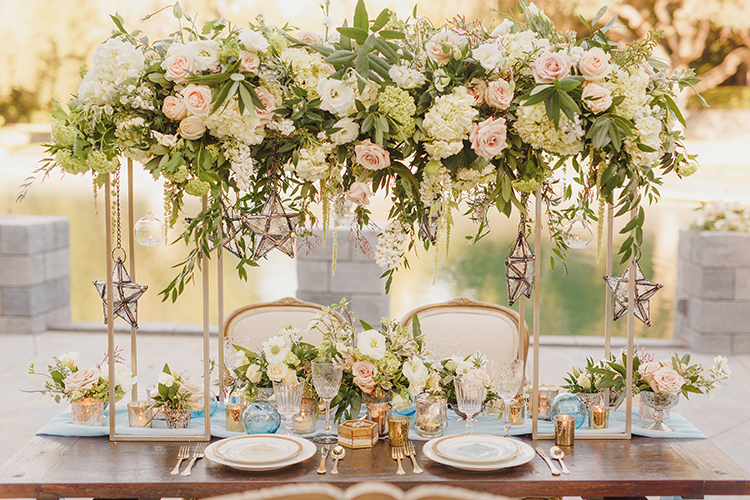 romantic wedding tables with tall centerpieces - photo by Kristen Booth Photographer https://ruffledblog.com/majestic-castle-wedding-inspiration-with-celestial-accents