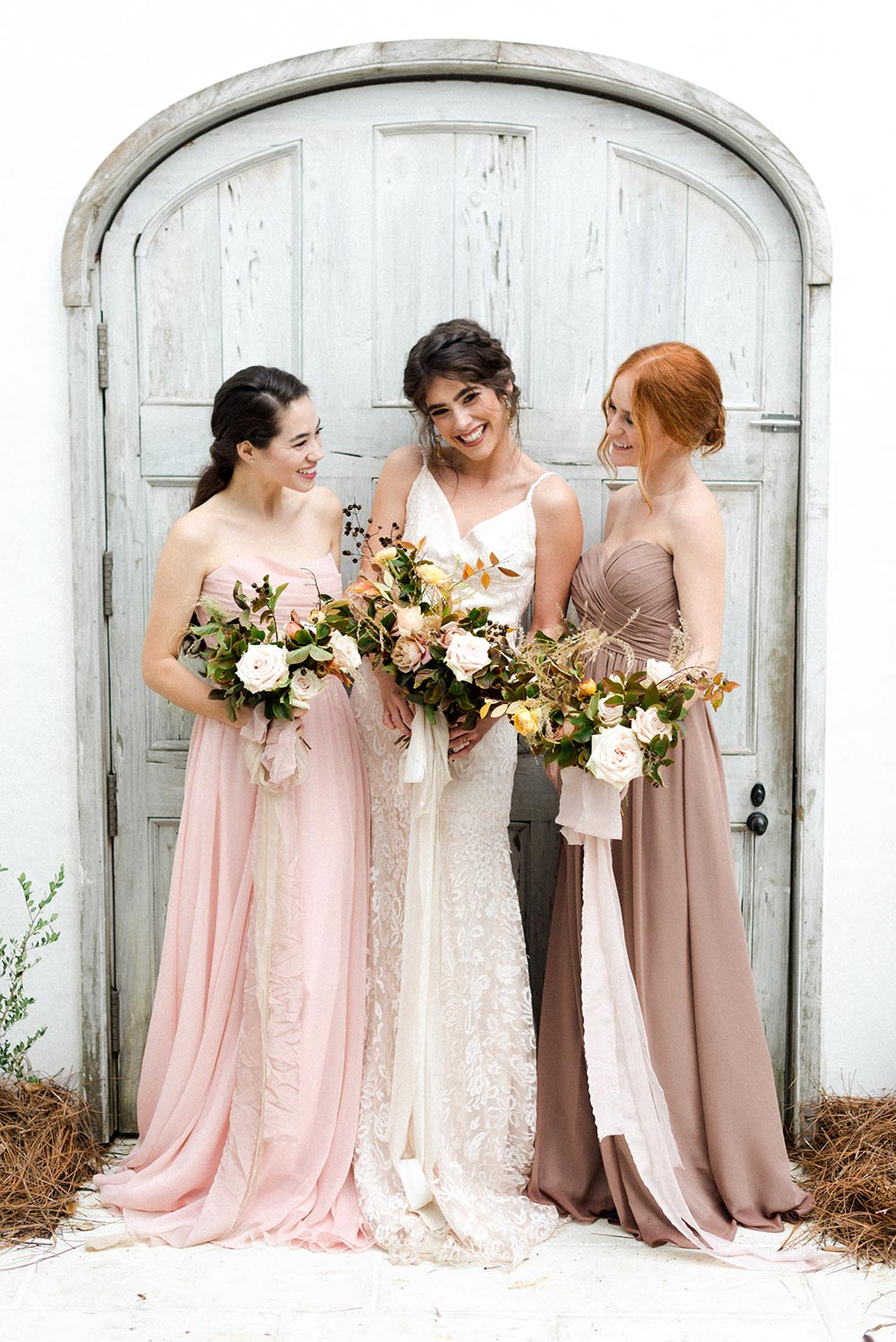 neutral mismatched bridesmaid dress with loose bouquets