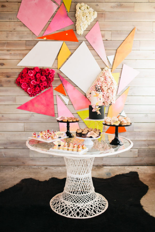 geometric wedding cake display backdrop - photo by Megan Welker http://ruffledblog.com/40-eye-catching-geometric-wedding-ideas