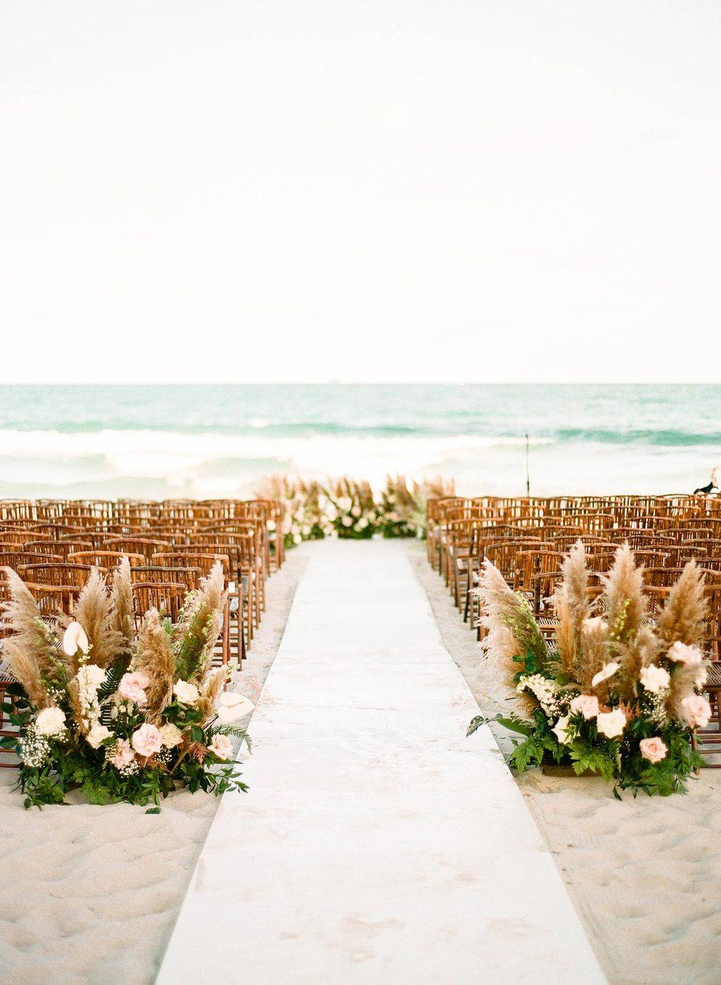 pampas grass wedding ceremony with bamboo chairs