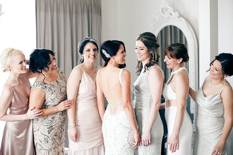chic bridesmaid style - photo by Kaylynn Marie Photography https://ruffledblog.com/midnight-in-paris-inspired-wedding-in-new-orleans