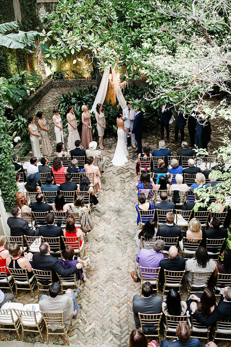 New Orleans garden wedding ceremonies - photo by Kaylynn Marie Photography http://ruffledblog.com/midnight-in-paris-inspired-wedding-in-new-orleans
