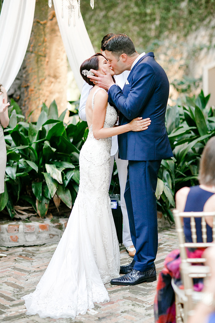 ceremony kiss - photo by Kaylynn Marie Photography http://ruffledblog.com/midnight-in-paris-inspired-wedding-in-new-orleans