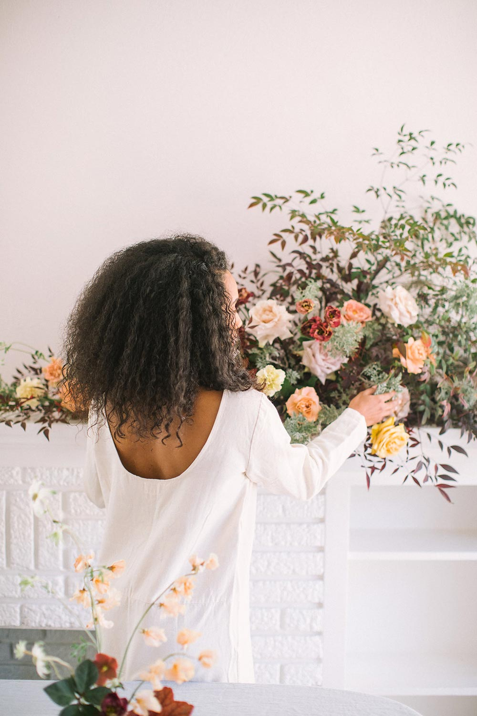 scoop back linen white dress and wild floral arrangement