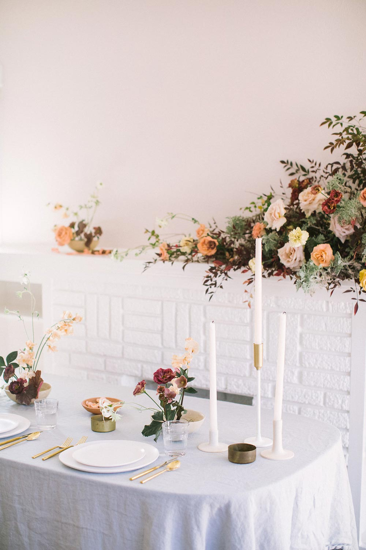 wild asymmetrical floral arrangement fine art wedding