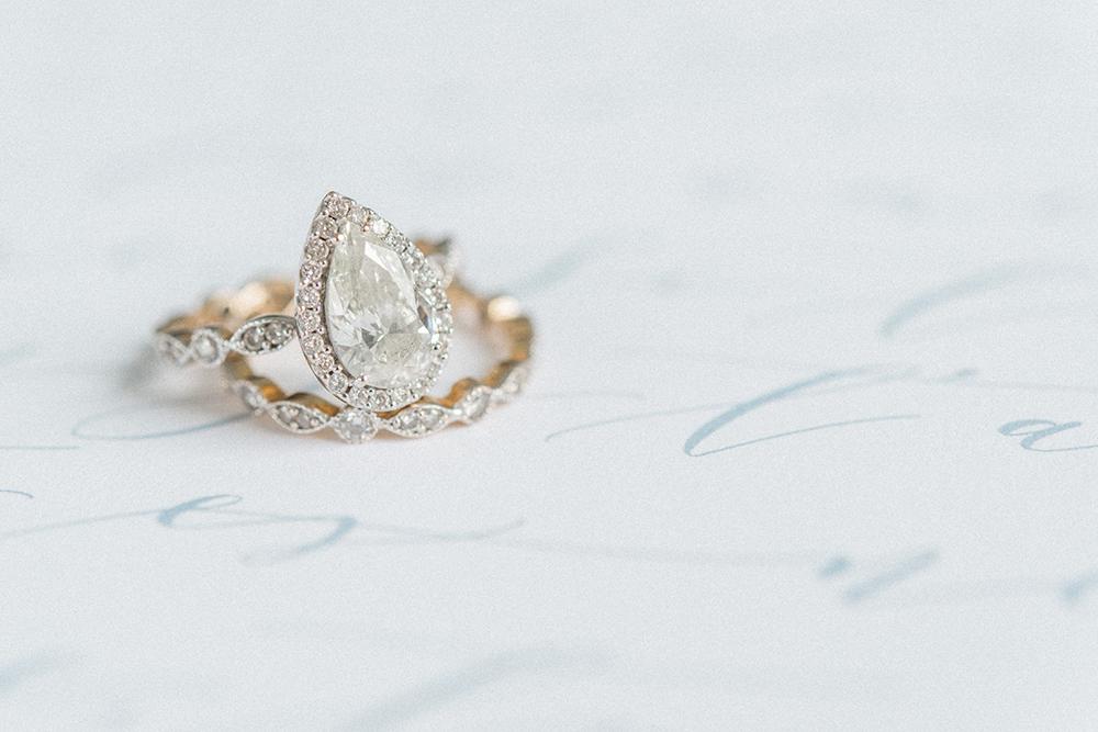 pear shaped engagement rings - photo by Laura Kelly Photography http://ruffledblog.com/minimalist-monochrome-european-wedding-inspiration