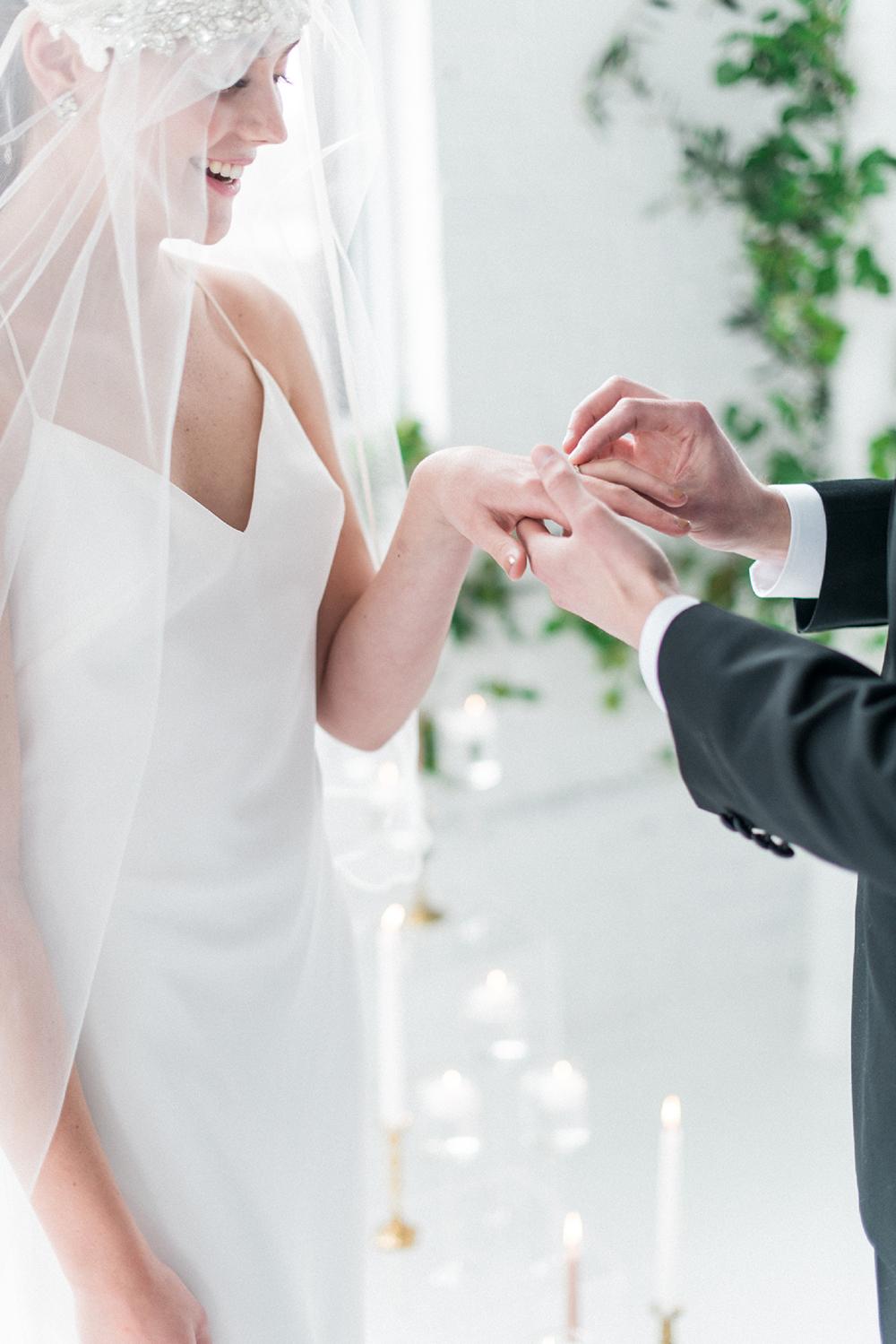 ring exchange - photo by Laura Kelly Photography https://ruffledblog.com/minimalist-monochrome-european-wedding-inspiration