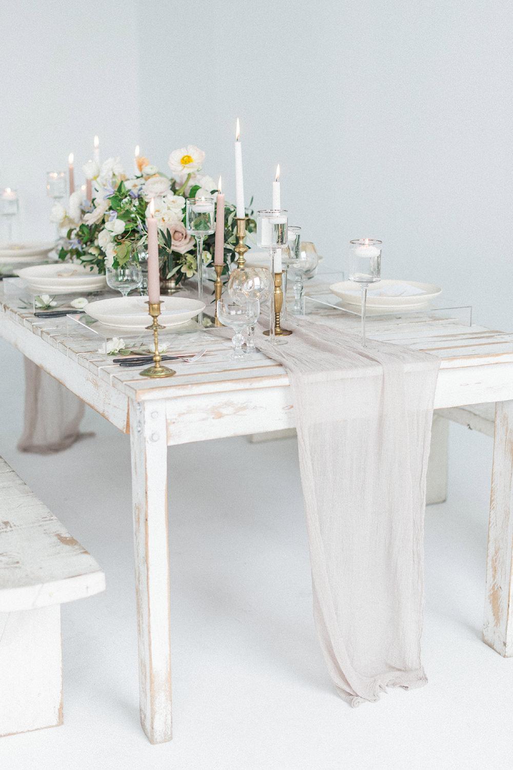 table runners - photo by Laura Kelly Photography https://ruffledblog.com/minimalist-monochrome-european-wedding-inspiration