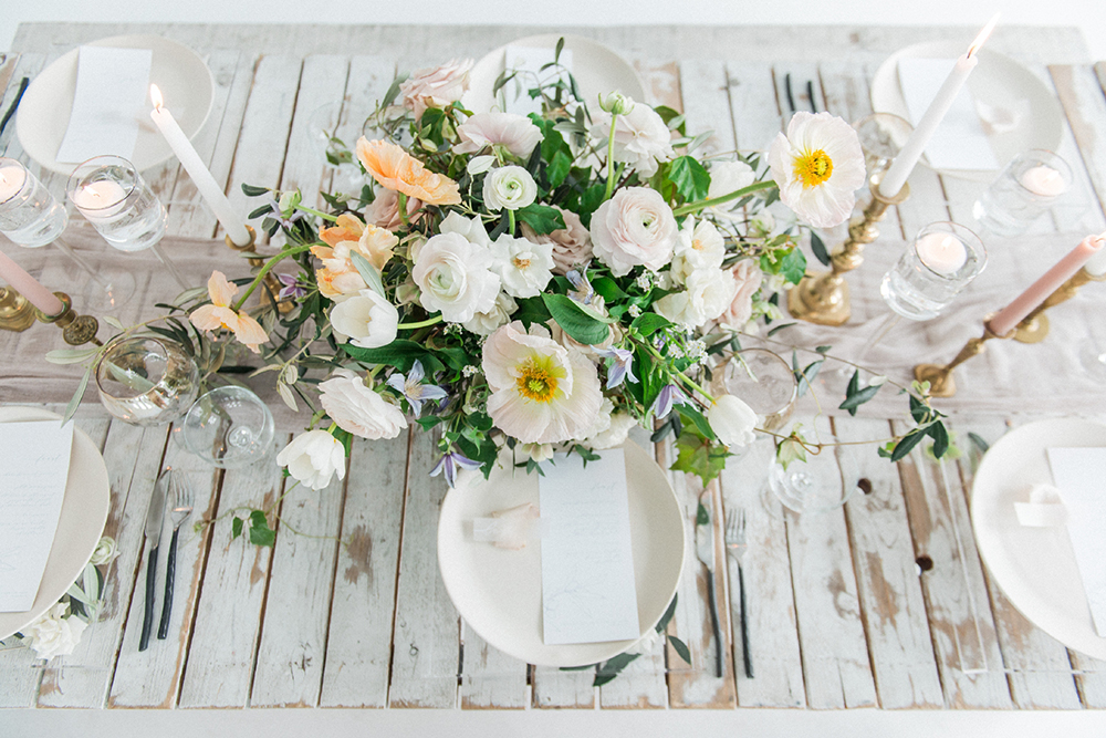 wedding tables - photo by Laura Kelly Photography https://ruffledblog.com/minimalist-monochrome-european-wedding-inspiration