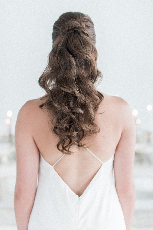 wavy wedding hair - photo by Laura Kelly Photography https://ruffledblog.com/minimalist-monochrome-european-wedding-inspiration