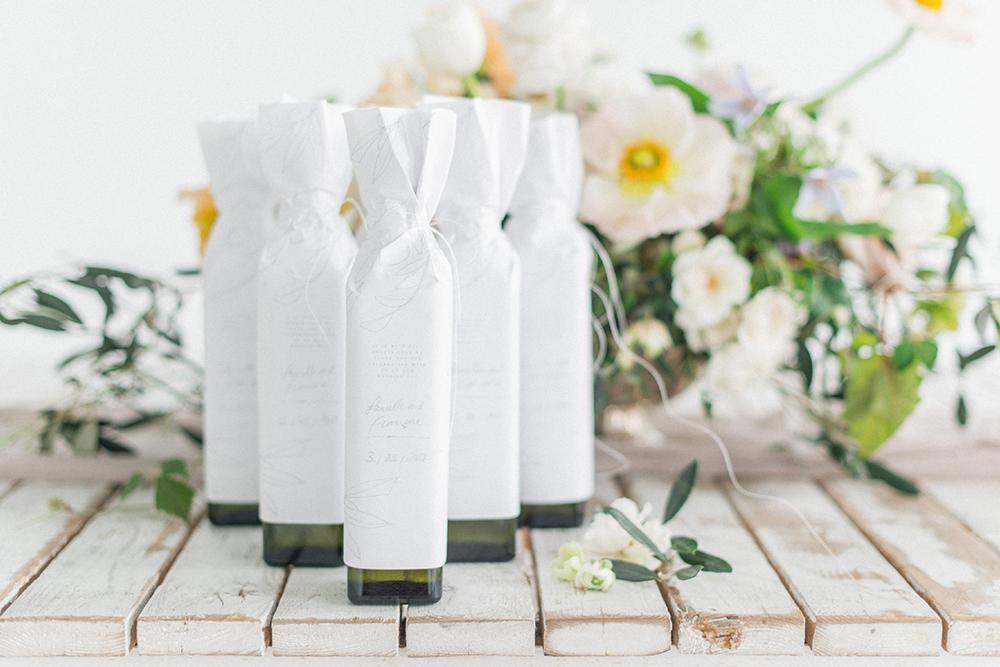 olive oil wedding favors - photo by Laura Kelly Photography http://ruffledblog.com/minimalist-monochrome-european-wedding-inspiration