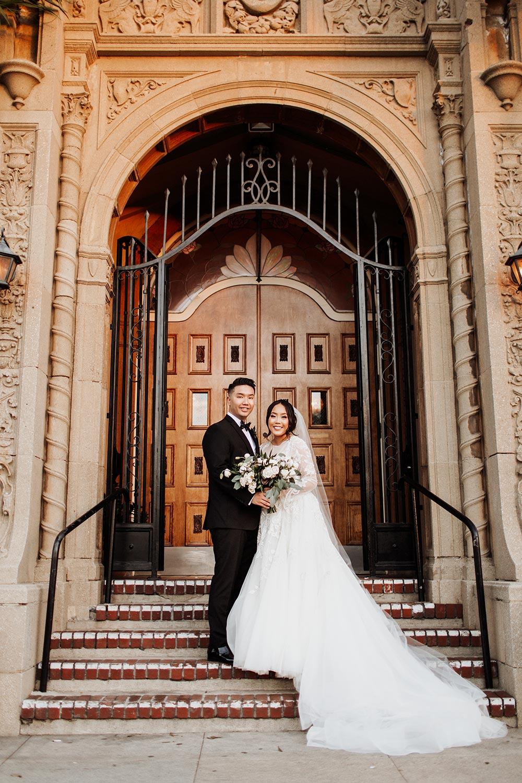 long sleeve tulle wedding dress and black groom tux historic wedding venue