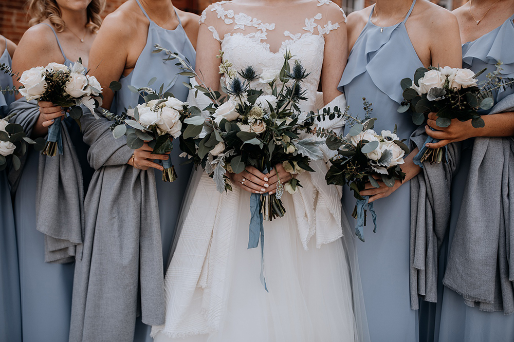 bridesmaids in blue and thistle bouquets - https://ruffledblog.com/modern-baltimore-mill-house-wedding