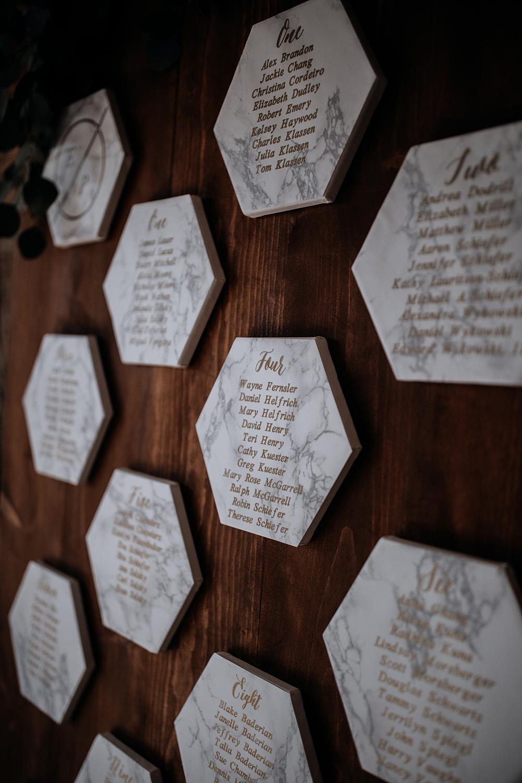 geometric seating charts with marble - https://ruffledblog.com/modern-baltimore-mill-house-wedding