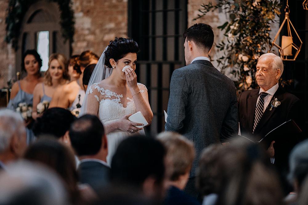 sweet wedding ceremony moments - https://ruffledblog.com/modern-baltimore-mill-house-wedding