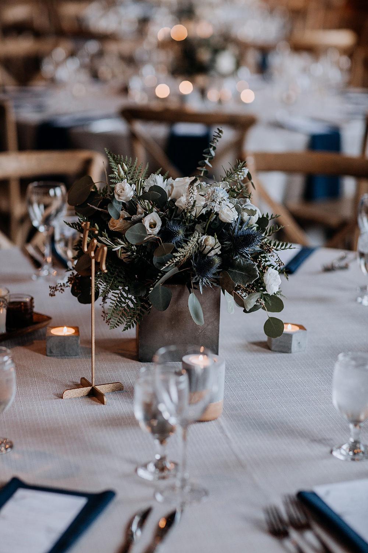 wedding reception centerpieces with thistle - https://ruffledblog.com/modern-baltimore-mill-house-wedding
