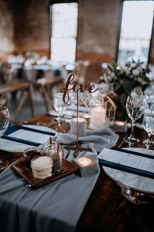 lasercut table numbers - https://ruffledblog.com/modern-baltimore-mill-house-wedding