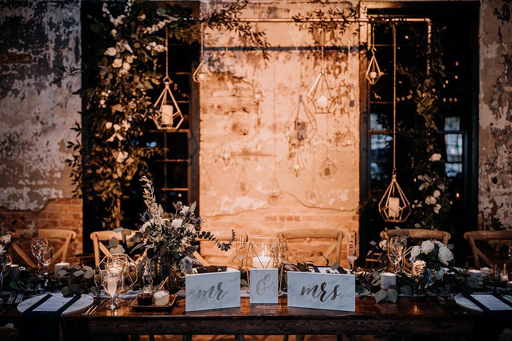 modern industrial wedding sweetheart tables - https://ruffledblog.com/modern-baltimore-mill-house-wedding