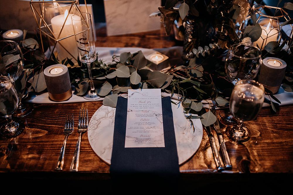 navy place setting ideas - https://ruffledblog.com/modern-baltimore-mill-house-wedding