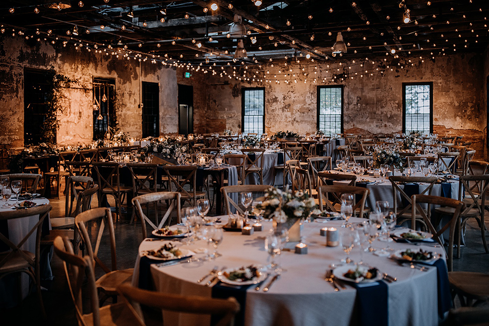 wedding receptions with string lights - https://ruffledblog.com/modern-baltimore-mill-house-wedding