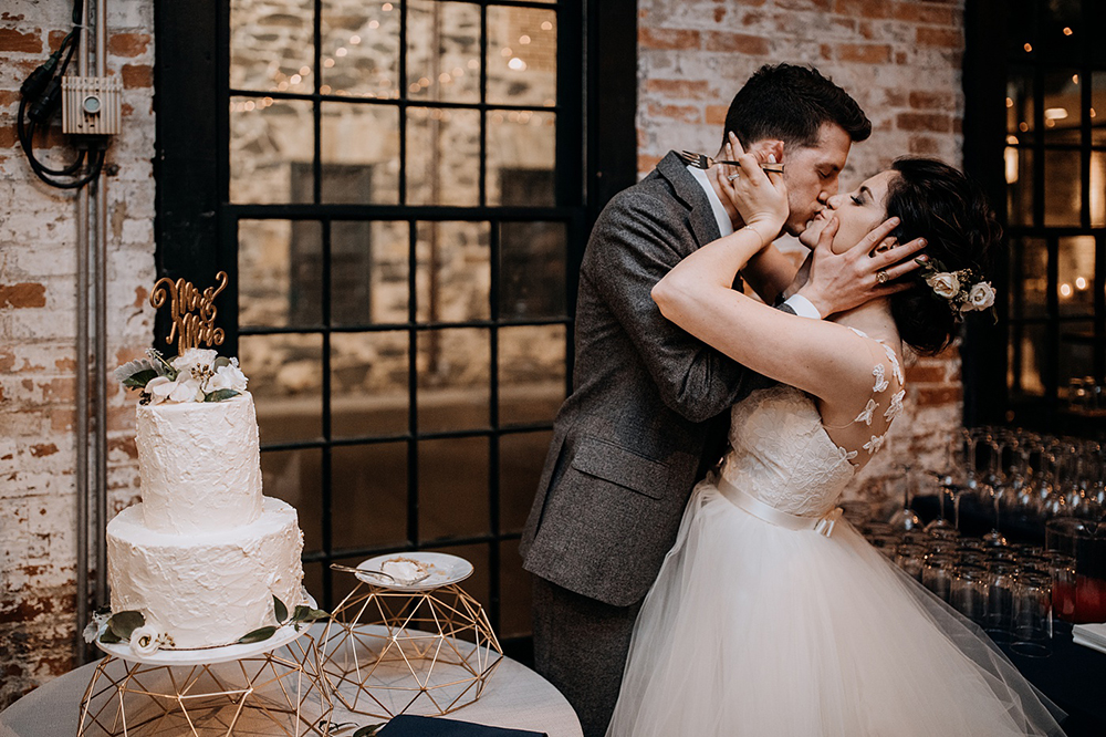 cake cutting - https://ruffledblog.com/modern-baltimore-mill-house-wedding