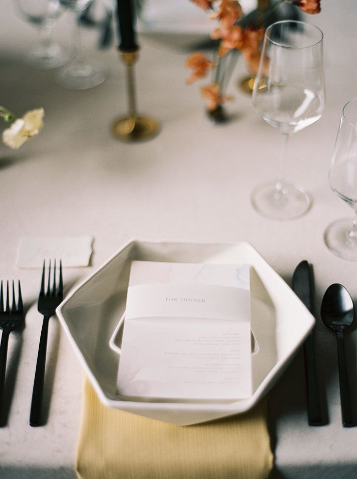 contemporary wedding place setting with black utensils