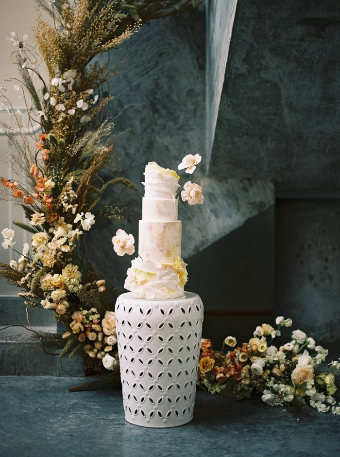 textured wedding cake with ruffled icing