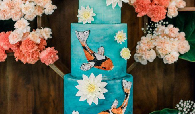 teal and orange koi fish wedding cake