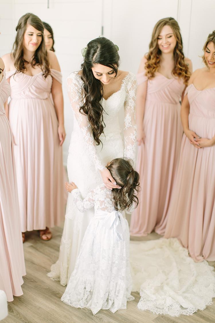 bride getting ready - photo by Mustard Seed Photography http://ruffledblog.com/modern-farmhouse-wedding-with-organic-details