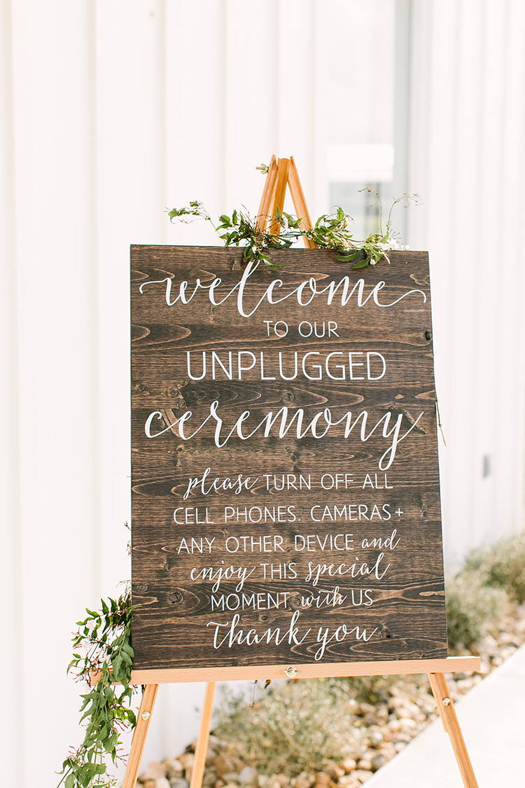 unplugged wedding ceremony signs - photo by Mustard Seed Photography https://ruffledblog.com/modern-farmhouse-wedding-with-organic-details