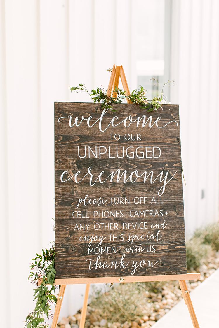 unplugged wedding ceremony signs - photo by Mustard Seed Photography http://ruffledblog.com/modern-farmhouse-wedding-with-organic-details