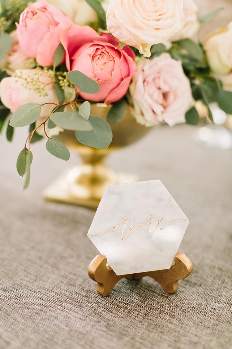 marble wedding details - photo by Mustard Seed Photography http://ruffledblog.com/modern-farmhouse-wedding-with-organic-details