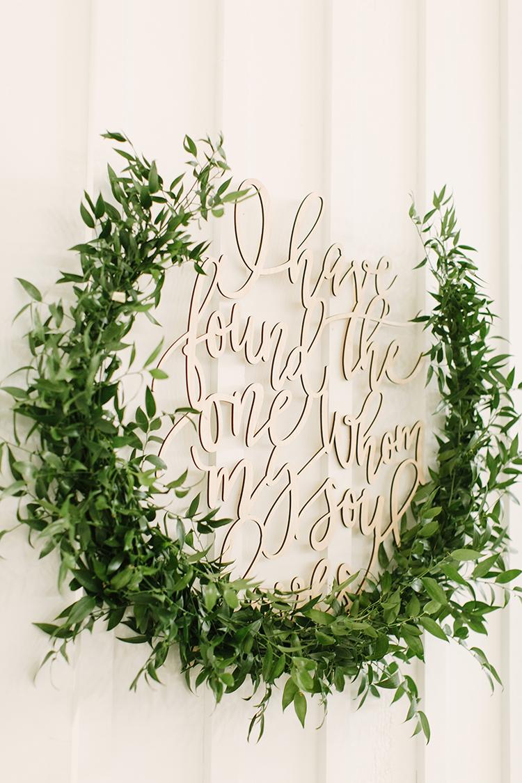 lasercut wedding signs - photo by Mustard Seed Photography http://ruffledblog.com/modern-farmhouse-wedding-with-organic-details
