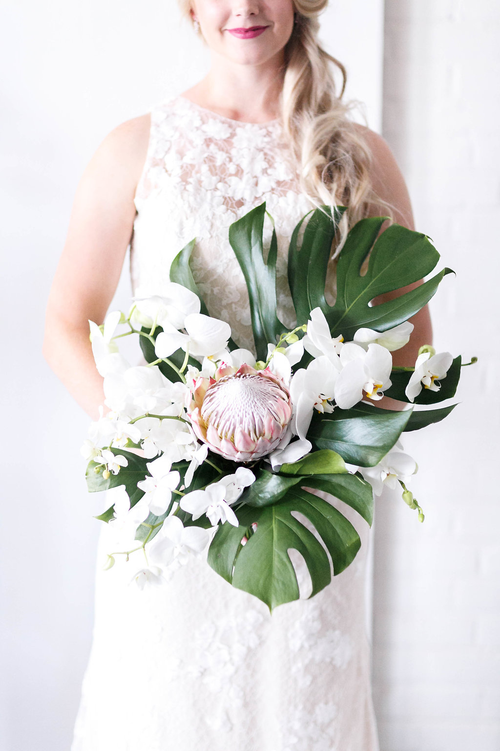 wedding bouquets with philodendron and protea - photo by Virginia Ashley Photography http://ruffledblog.com/modern-industrial-wedding-inspiration-with-tropical-vibes