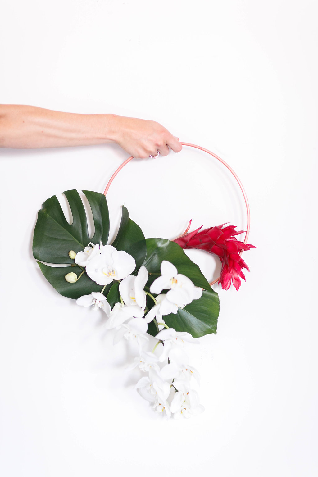 tropical wreath bouquets - photo by Virginia Ashley Photography http://ruffledblog.com/modern-industrial-wedding-inspiration-with-tropical-vibes