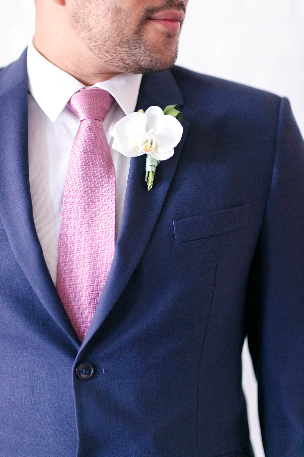 white orchid boutonnieres - photo by Virginia Ashley Photography http://ruffledblog.com/modern-industrial-wedding-inspiration-with-tropical-vibes