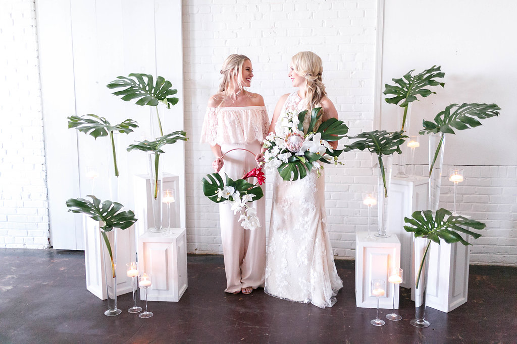 bride and bridesmaid - photo by Virginia Ashley Photography http://ruffledblog.com/modern-industrial-wedding-inspiration-with-tropical-vibes