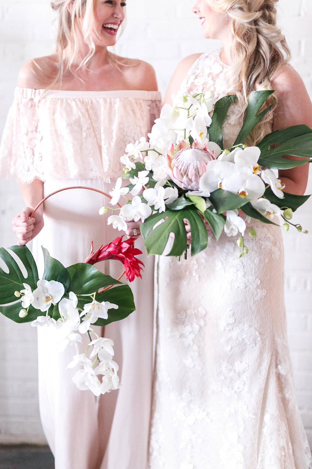 tropical bouquets with philodendron - photo by Virginia Ashley Photography http://ruffledblog.com/modern-industrial-wedding-inspiration-with-tropical-vibes
